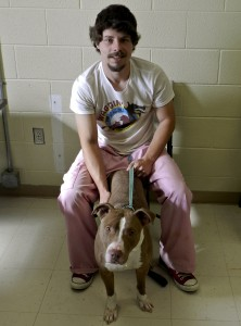 Derek Rauschelbach sits with Mosby at the Humane Society of Warren County.  Henry Culvyhouse/Daily
